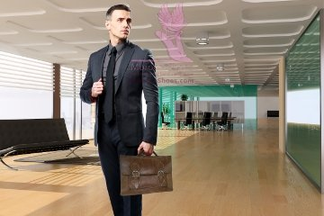 Confident businessman with bag looking away